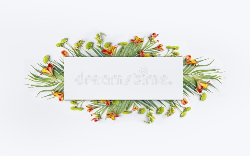 Summer tropical creative design with palm leaves and exotic flowers for banner or flyer on white stock images