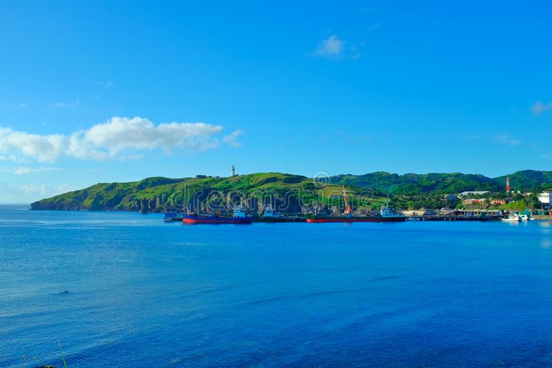 Summer tropical destination in the Philippines. A local seaport with calm blue sea and sky. Basco Port, Basco, Batanes, Philippines royalty free stock image