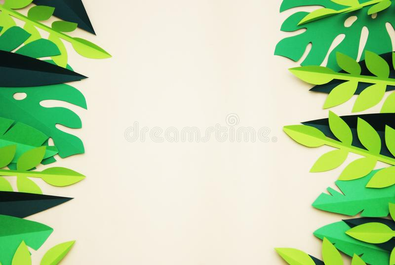 Summer Tropical Paper Cut leaves, Frame. Exotic summertime. Space for text. Beautiful dark green jungle floral background. Monster stock photos