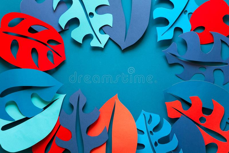 Summer tropical plant background. Monstera leaves frame. Vibrant colors. Paper cut style. Flat lay. Copy space.  stock images