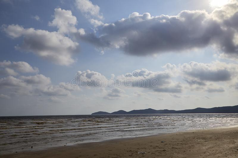 Summer tropical sea, beach. Wave and blue sky at Hat Laem Sing beach in Chanthaburi province, Thailand stock image