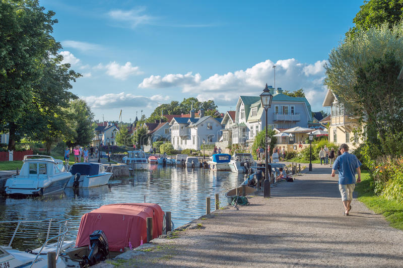 Summer in Trosa, Sweden. Trosa, Sweden – August 6, 2015: Leisure boats moored at the harbor along the outflow of Trosa river into the Baltic sea. Trosa is royalty free stock images