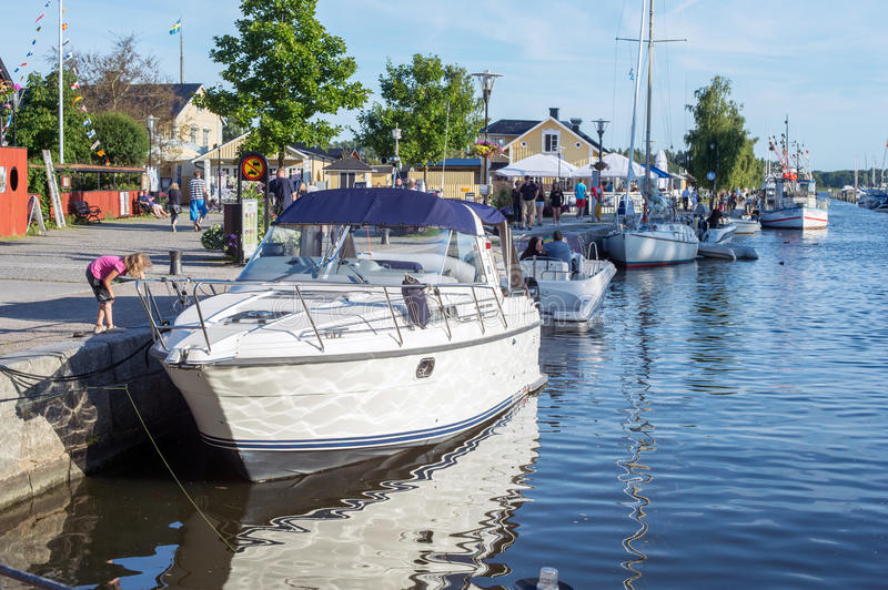 Summer in Trosa, Sweden. Trosa, Sweden – August 6, 2015: Leisure boats moored at the harbor along the outflow of Trosa river into the Baltic sea. Trosa is stock images