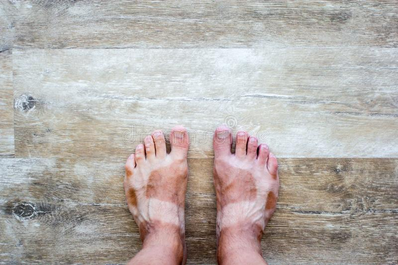 Male legs with suntanned shape of sandals. Summer vacation background - male legs with suntanned shape of sandals royalty free stock photography