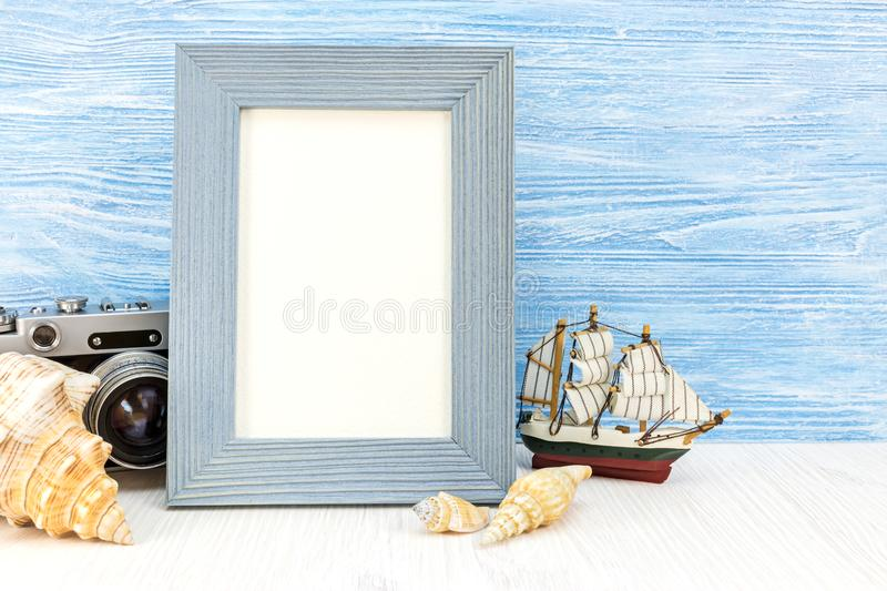 Summer vacation background with old camera, photo frame, ship an royalty free stock image