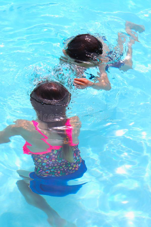 Pool Fun With Kids Playing Underwater During Summer Vacation royalty free stock photos