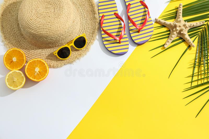 Summer vacation composition on two tone background. Space for text. Top view royalty free stock photography