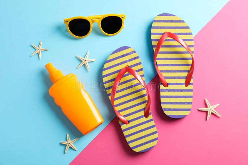 Summer vacation composition on two tone background. Top view. Closeup royalty free stock image