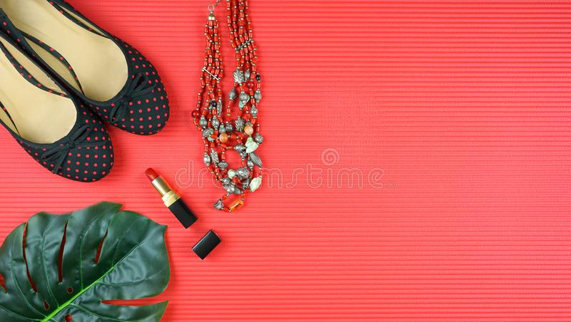 Summer vacation concept flatlay with summer dress and feminine accessories. Summer vacation concept flatlay with summer dress and feminine accessories on red royalty free stock photos