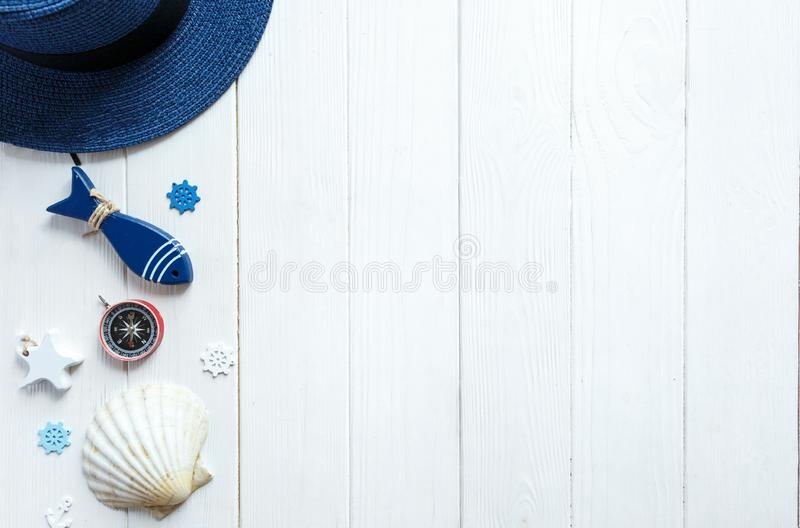 Summer vacation flat lay with beach accessories on a wooden background. Travel essentials from above with copy stock images