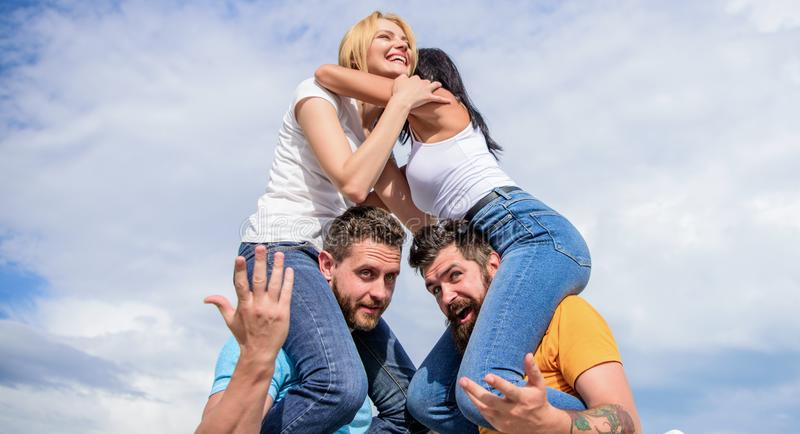 Summer vacation and fun. Couples on double date. Inviting another couple to join. Friendship of families. Twice fun on stock images