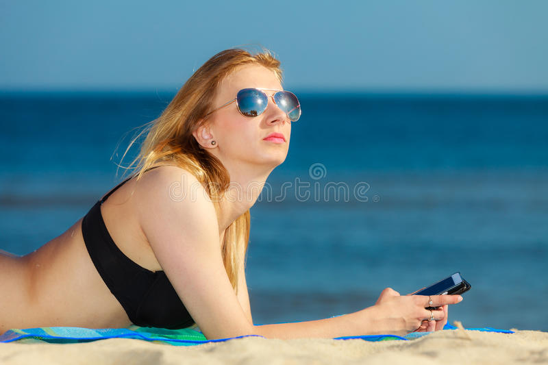 Download Summer Vacation Girl With Phone Tanning On Beach Stock Photo - Image: 39146584