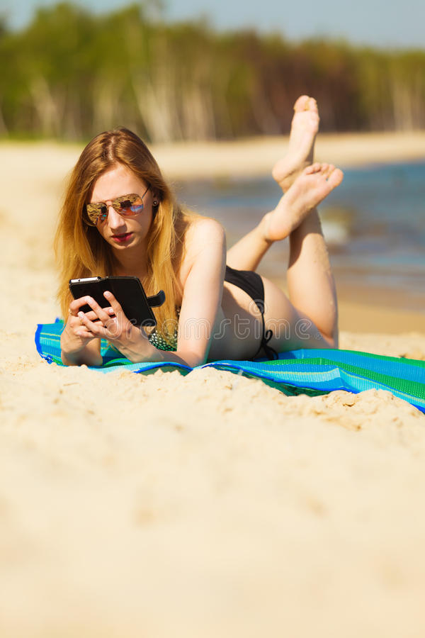 Download Summer Vacation Girl With Phone Tanning On Beach Stock Image - Image of sunbathing, pleasure: 39506941