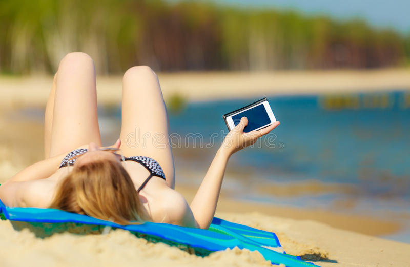 Download Summer Vacation Girl With Phone Tanning On Beach Stock Photo - Image: 40357104