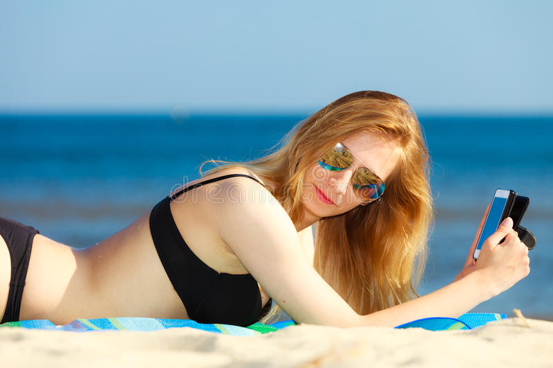 Download Summer Vacation Girl With Phone Tanning On Beach Stock Image - Image: 40789089