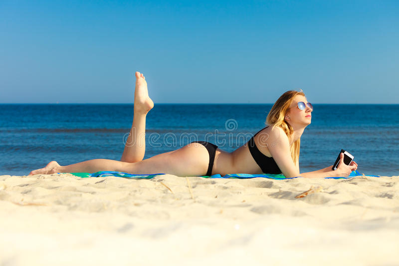 Download Summer Vacation Girl With Phone Tanning On Beach Stock Photo - Image of happiness, holiday: 41192994