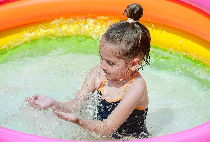 Summer vacation and holiday concept: happiness caucasian cute little girl has feeling funny and enjoy in swimming pool stock images