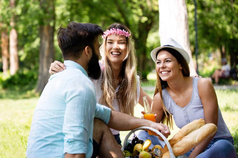 Summer, vacation, music and recreation time concept. Group of friends have picnic outdoor. royalty free stock photo