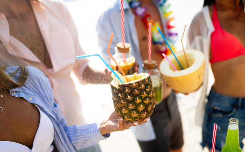 Summer, vacation, party, people concept. Group of friends having fun and party on the beach. stock photography