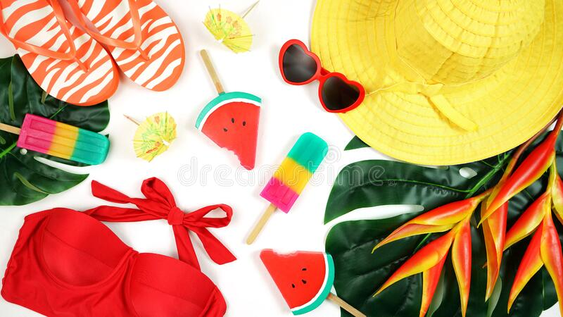 Summer vacation resort theme flat lay in bright summery colors. royalty free stock photography