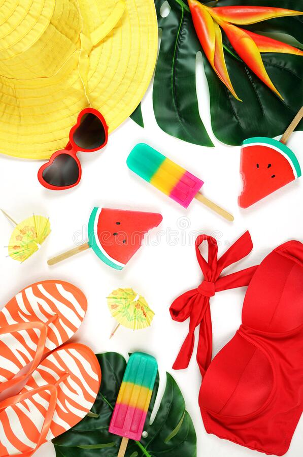Summer vacation resort theme flat lay in bright summery colors. royalty free stock photos