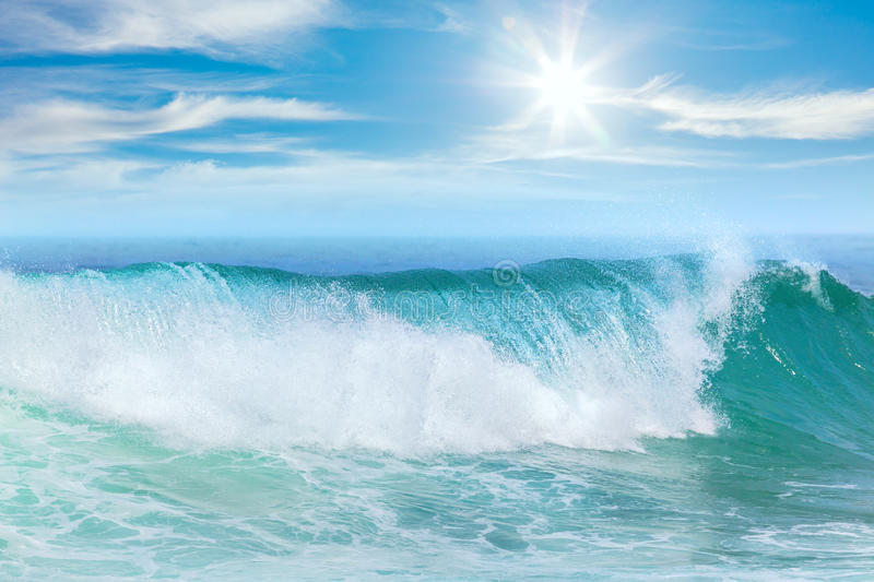 Summer vacation on the Sea. Beautiful wave and blue sky with sunbeams stock photo