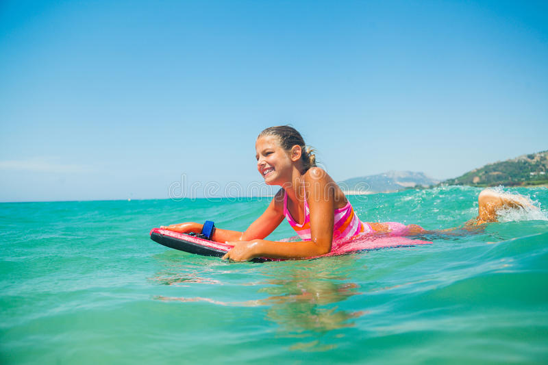 Summer vacation - surfer girl. stock photography