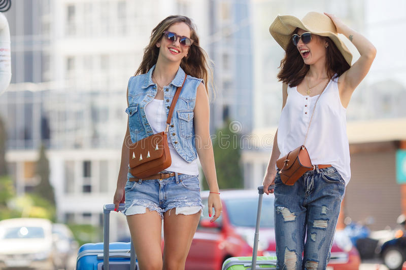 Summer vacation to beautiful women travelling by car royalty free stock photos