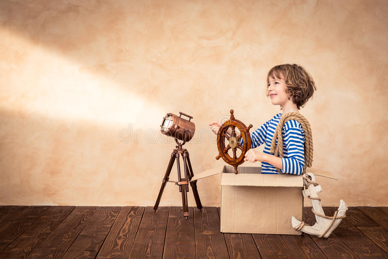 Summer vacation and travel concept. Child pretend to be sailor. Kid having fun at home. Summer vacation and travel concept stock image