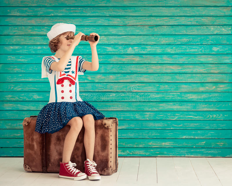 Summer vacation and travel concept. Child pretend to be sailor. Kid having fun at home. Summer vacation and travel concept stock images