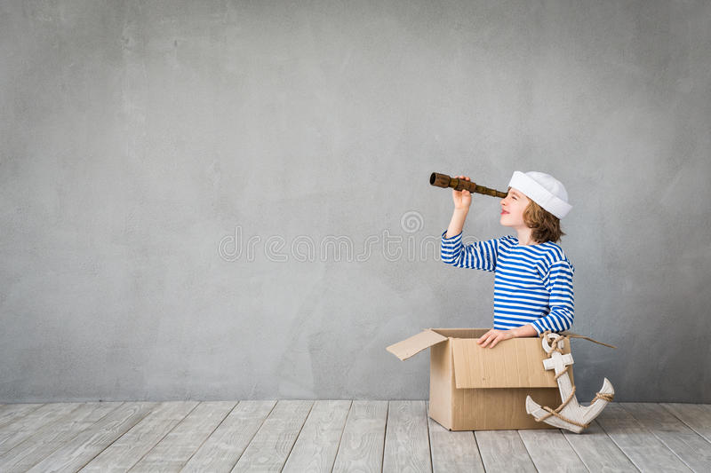 Summer vacation and travel concept. Child pretend to be sailor. Kid having fun at home. Summer vacation and travel concept royalty free stock image