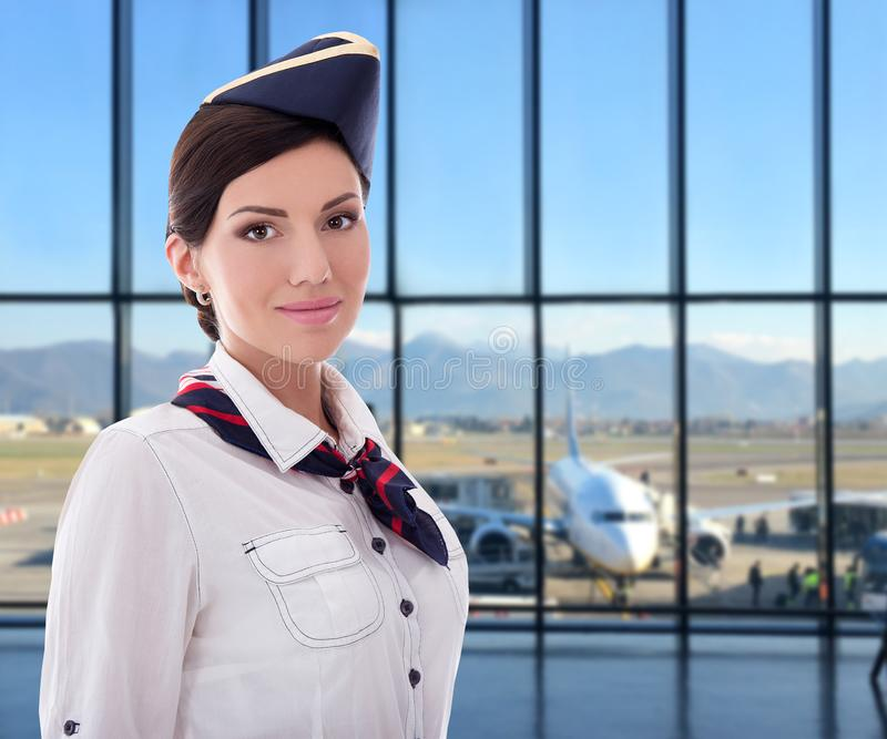 Summer, vacation and travel concept - portrait of stewardess in airport royalty free stock photo