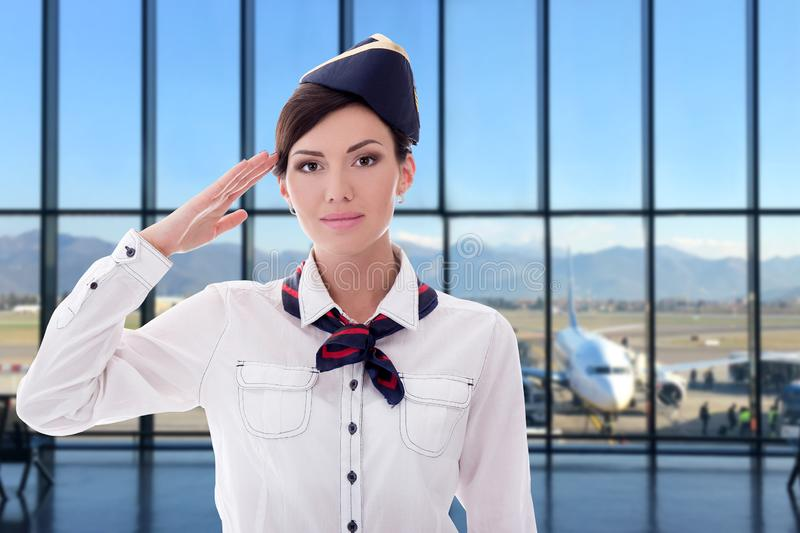 Summer, vacation and travel concept - young stewardess posing in airport stock photos
