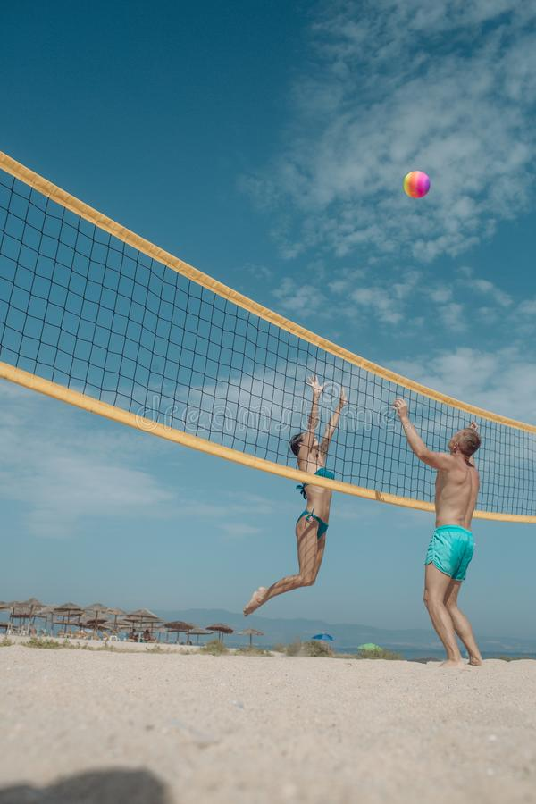 Summer vacation and travel on holiday in Miami. Sexy woman and muscular man with ball at net. Love and flirting of stock photo