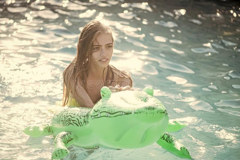 Summer vacation and travel to ocean, maldives. Fashion crocodile leather and girl in water. Adventures of girl on. Crocodile. Relax in luxury swimming pool royalty free stock images