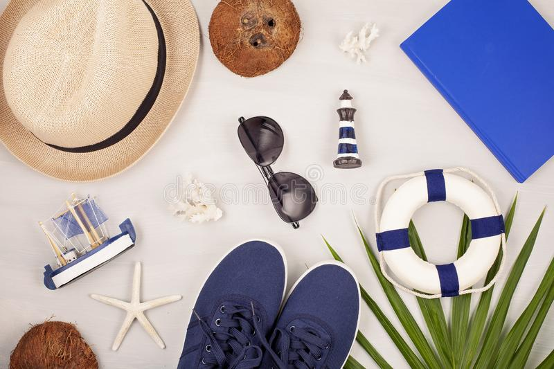 Summer vacation, travel, tourism concept flat lay. Beach, casual urban accessories for men. Summer vacation, travel, tourism concept flat lay. Beach, casual stock image