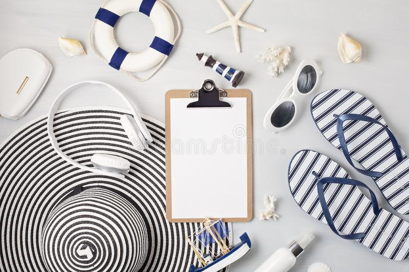 Summer vacation, travel, tourism concept flat lay. Beach, countryside, casual urban accessories. Top view royalty free stock photography