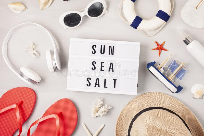 Summer vacation, travel, tourism concept flat lay. Beach, countryside, casual urban accessories. Top view royalty free stock photo