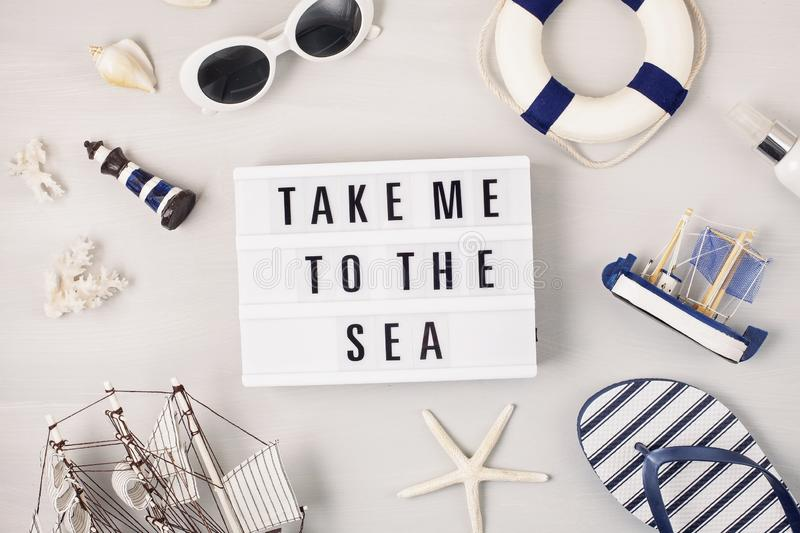 Summer vacation, travel, tourism concept flat lay. Marine beach accessories top view with lightbox stock photos