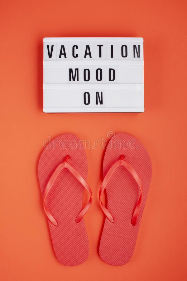 Summer vacation, travel, tourism concept flat lay. Tropical beach accessories top view with light box with text vacation mood on stock image