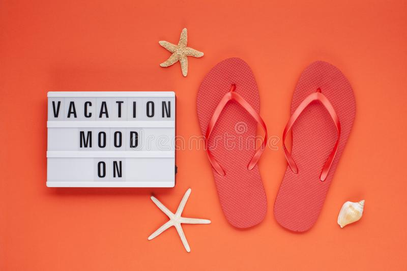 Summer vacation, travel, tourism concept flat lay. Tropical beach accessories top view with light box with text vacation mood on royalty free stock photo