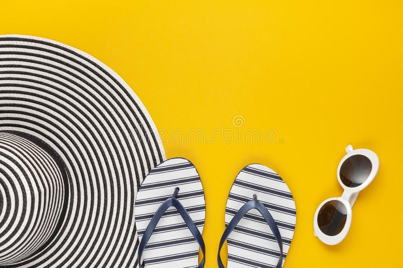 Summer vacation, travel, tourism concept flat lay. Tropical beach accessories top view with sunglasses, hat and flip flops royalty free stock photo