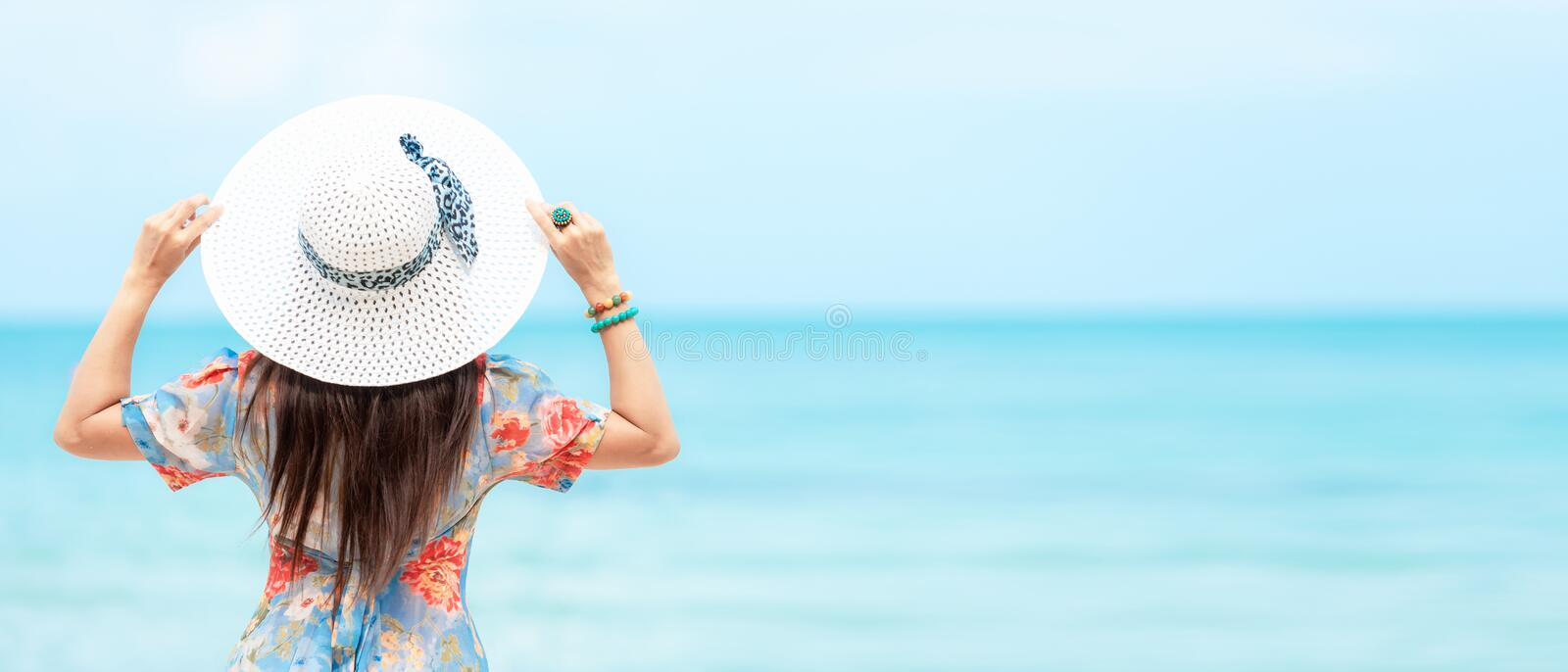 Summer Vacation.  Traveler women relaxing and joy fun on the beach, so happy and luxury and destination in holiday summer.  Touris stock photos