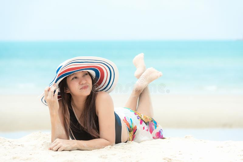 Summer Vacation.  Traveler women relaxing and joy fun on the beach, so happy and luxury and destination in holiday summer.  Touris royalty free stock photography