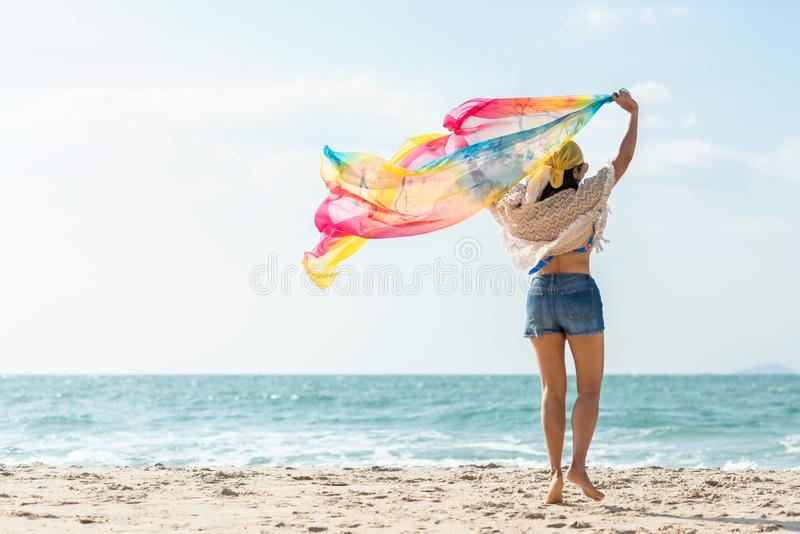 Summer Vacation.  Traveler women relaxing and joy fun on the beach, so happy and luxury and destination in holiday summer.  Touris stock images