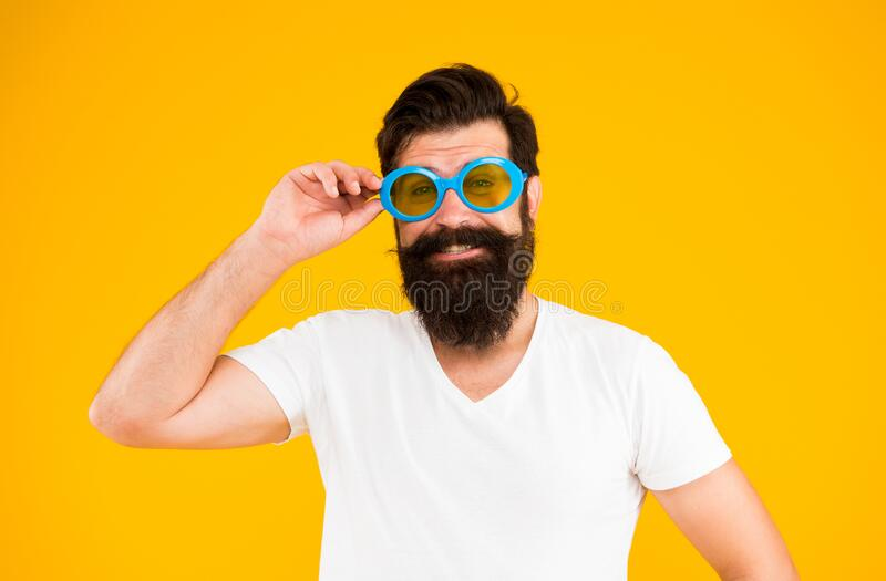 Summer vacation. Ultraviolet protection concept. Man eyewear model. Handsome guy wear sunglasses. Hipster bearded man in royalty free stock photography