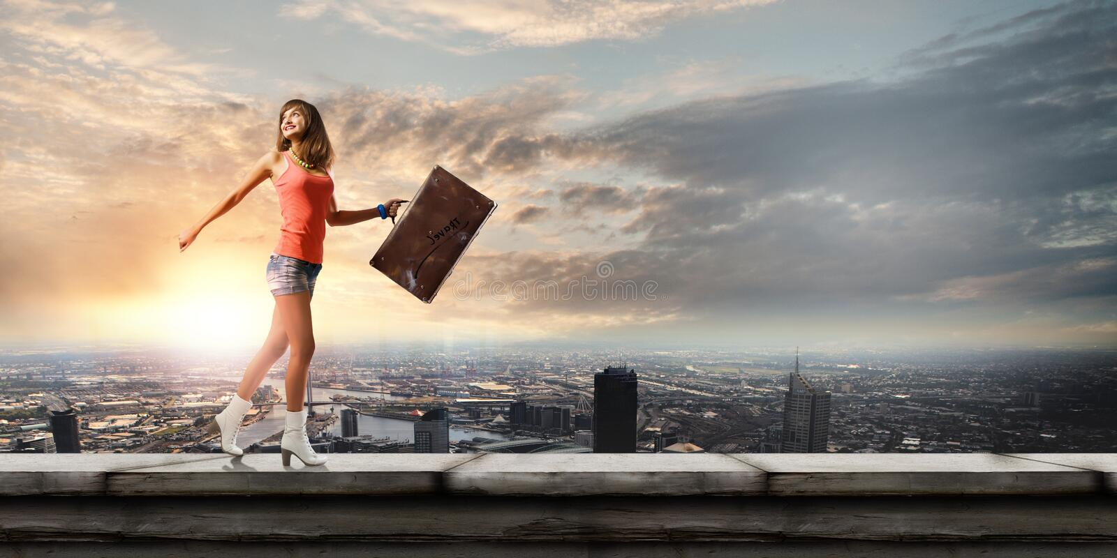 Summer vacation. Young pretty woman walking with suitcase in hand stock photos