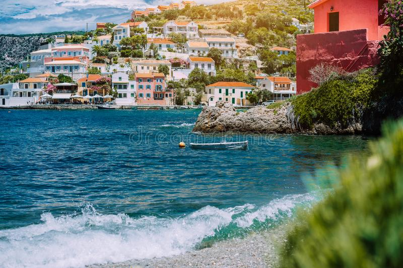 Summer vacations scenery. Mediterranean town Assos on Kefalonia in Greece. View of beautiful beach and colored houses stock photo