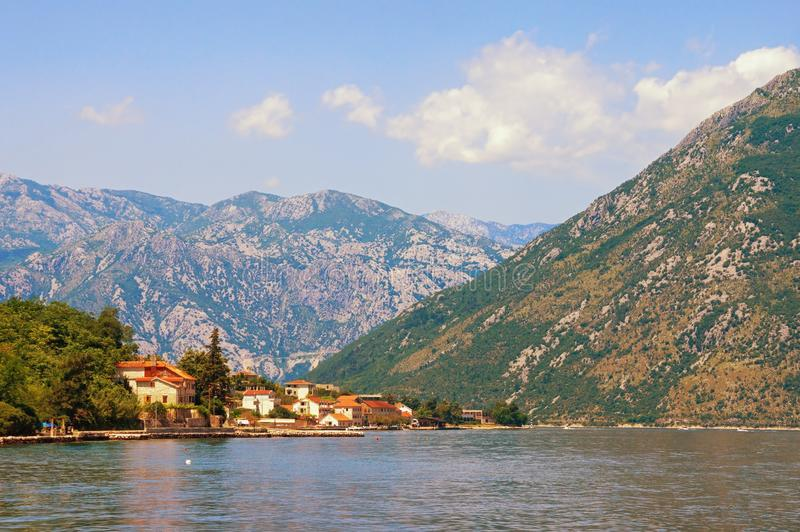 Summer vacations. Sunny landscape with sea, mountains and small seaside town. Montenegro, Bay of Kotor. Summer vacations. Sunny  landscape with sea, mountains stock photography