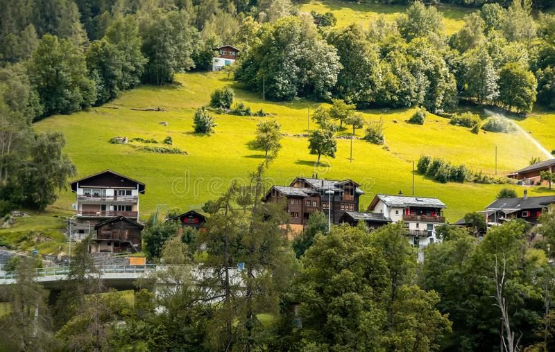 Summer view of a alpine chalets in Switzerland. Beautiful outdoor scene in Swiss Alps. royalty free stock images